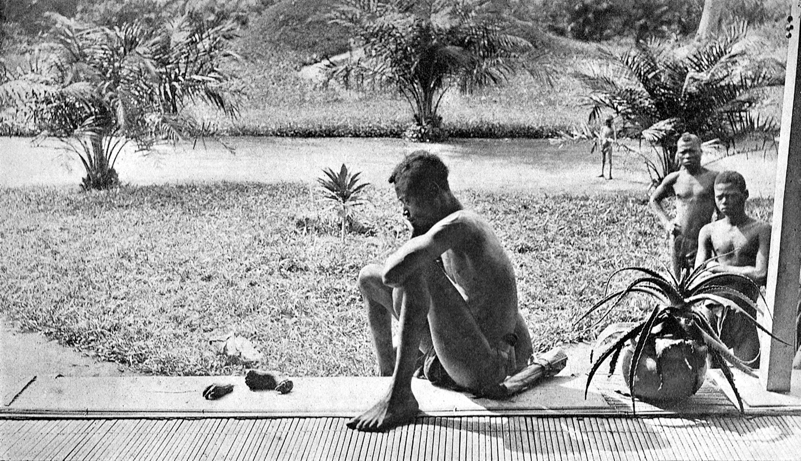 Nsala sits with the hand and foot of his five-year-old daughter, Boali, 1904. The systematic cutting off of hands was widely practiced in King Leopold's Congo. Photograph: Alice Seeley Harris. Source: Wikimedia Commons.